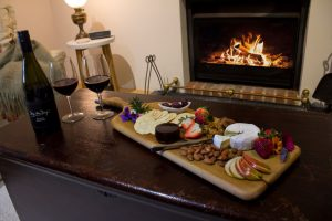 Seppeltsfield Vineyard Cottage luxury Barossa accommodation, - wine and cheese by the fireplace
